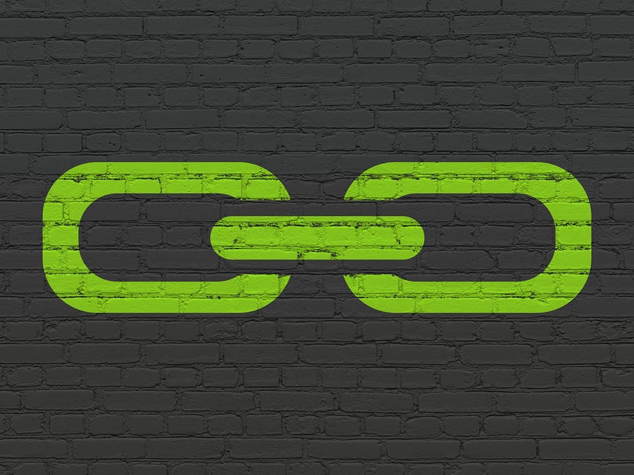 Web design concept: Painted green Link icon on Black Brick wall background