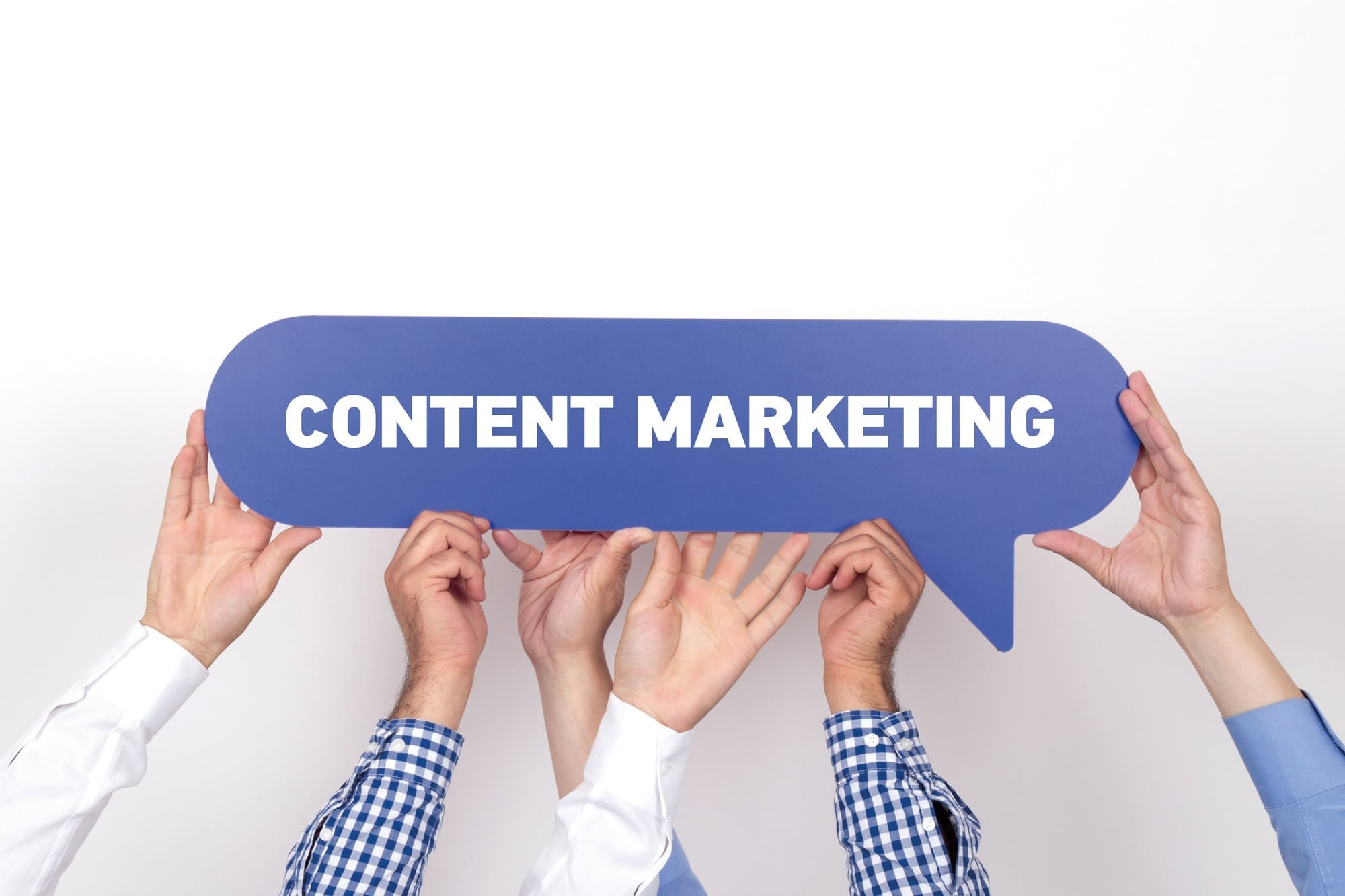 Group of people holding the CONTENT MARKETING written speech bubble