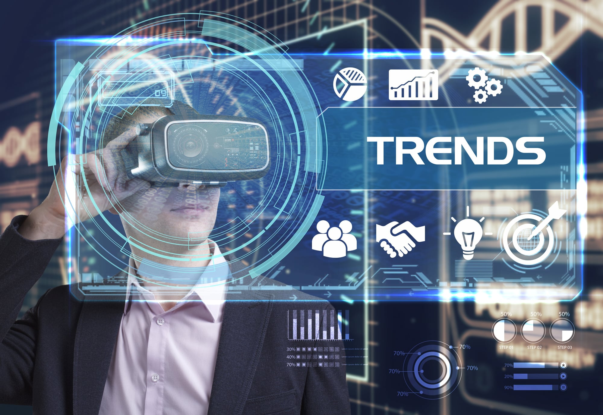 Business, Technology, Internet and network concept. Young businessman working in virtual reality glasses sees the inscription: trends
